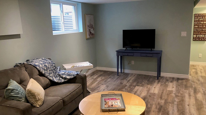 Basement with hardwood flooring