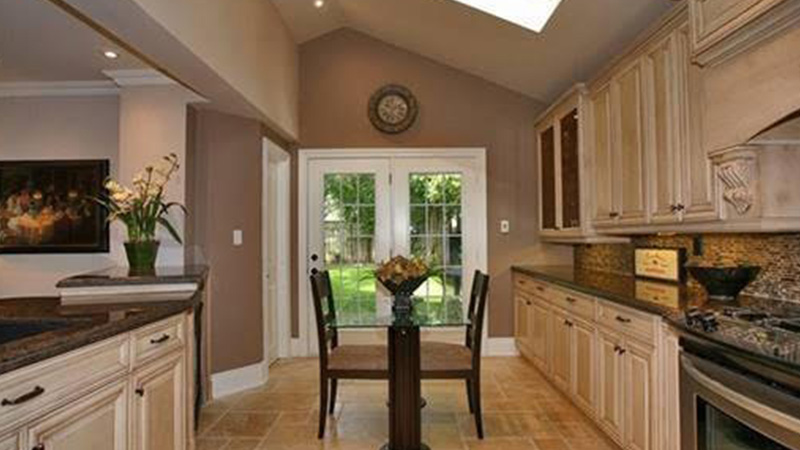 Kitchen with vaulted ceiling and skylights