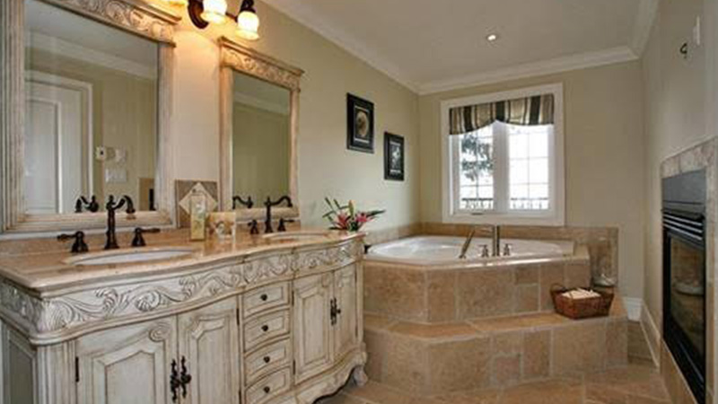 bathroom with jacuzzi and fireplace