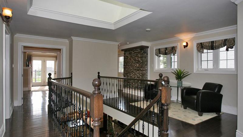 Upstairs hallway with skylight