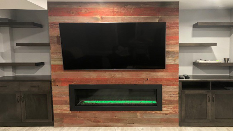 wall-mounted tv over a fireplace